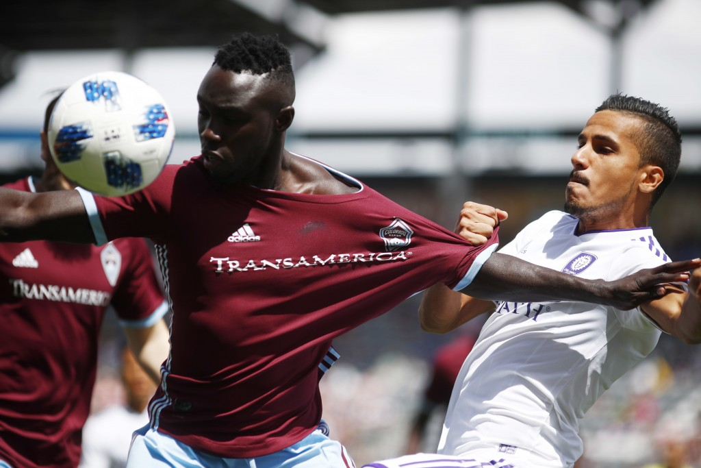 Colorado Rapids defender Bismark Adjei-Boateng, left, fights for control of the ball with Orlando City defender Mohamed El-Munir in the first half of ...