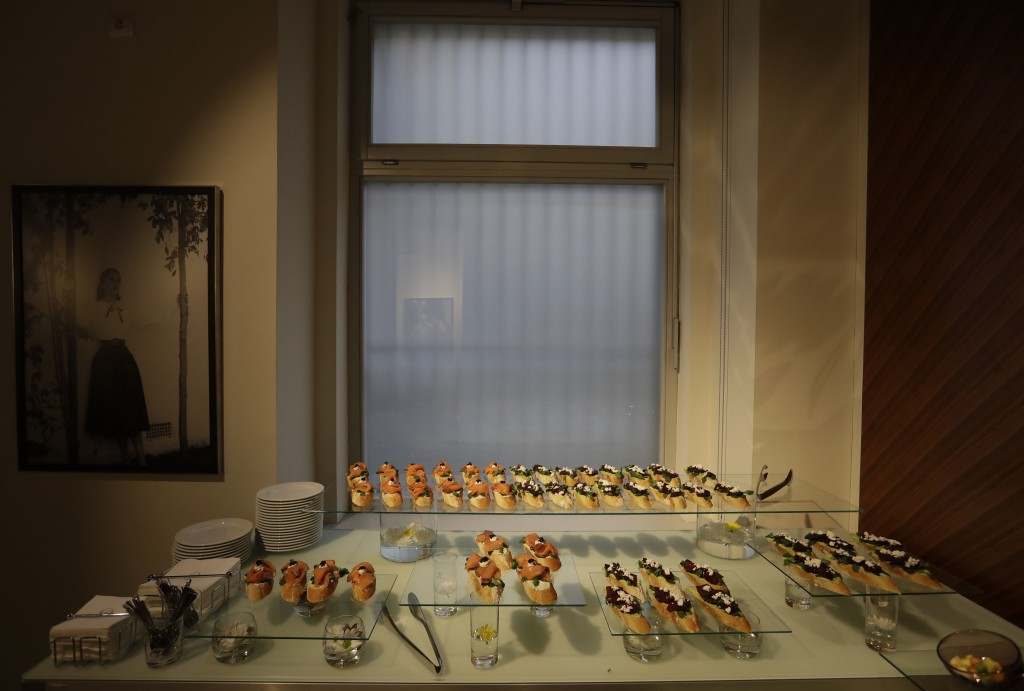 In this picture taken on Monday, Jan. 8, 2018, open-face sandwiches are prepared for journalist at a press conference in Prague, Czech Republic. With ...