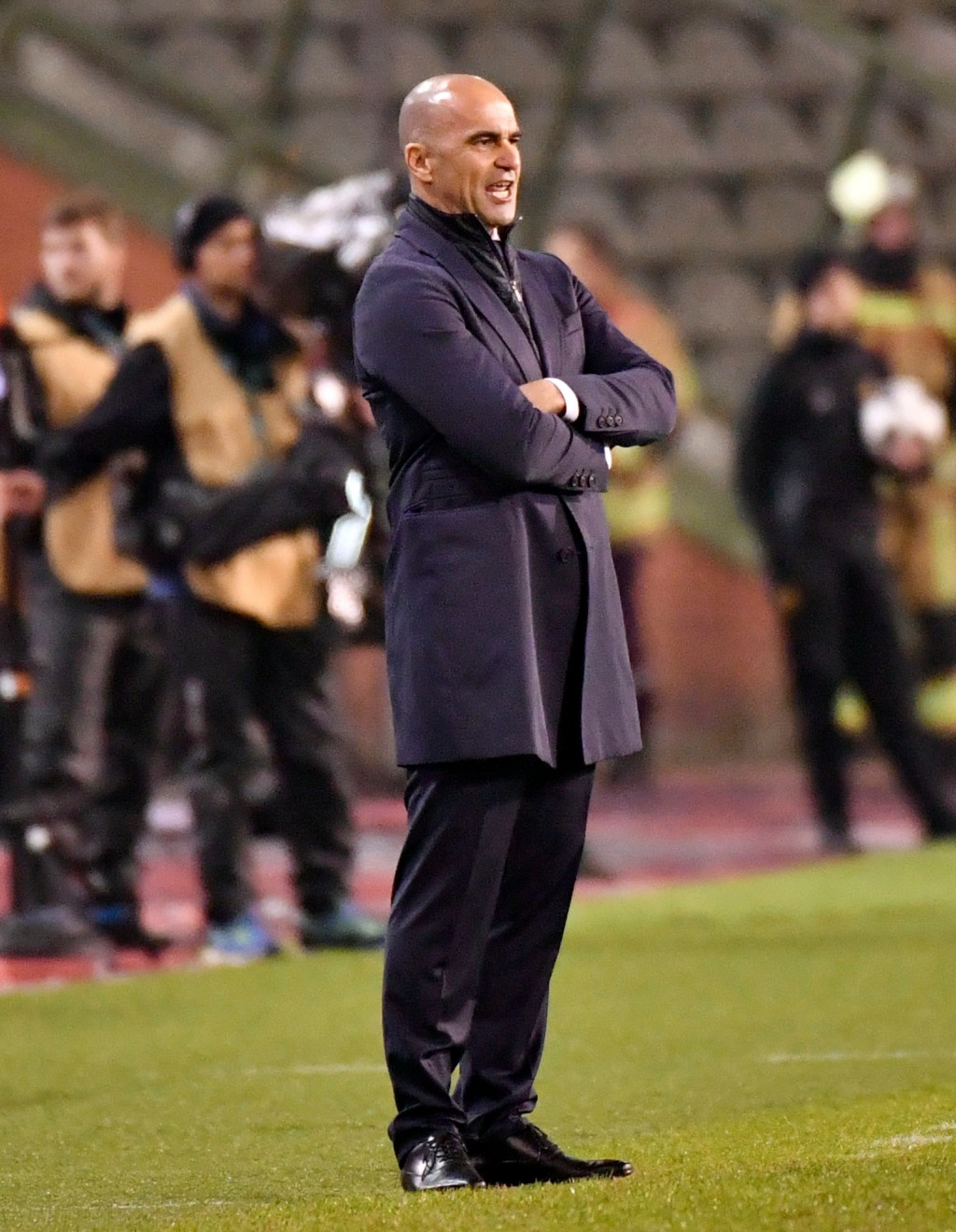 FILE - In this Tuesday, March 27, 2018 filer, Belgium's coach Roberto Martinez stands on the sideline during an international friendly soccer match be...