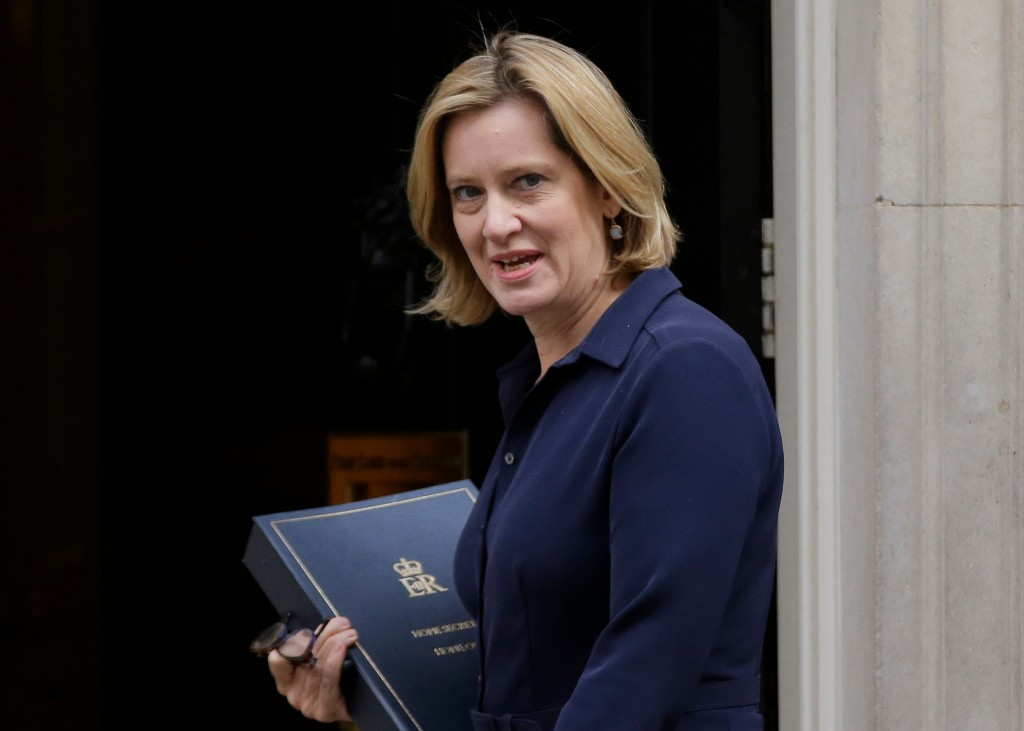 FILE - In this Thursday, Sept. 21, 2017 file photo Britain's Home Secretary Amber Rudd looks at the media as she arrives for a Cabinet meeting at 10 D...