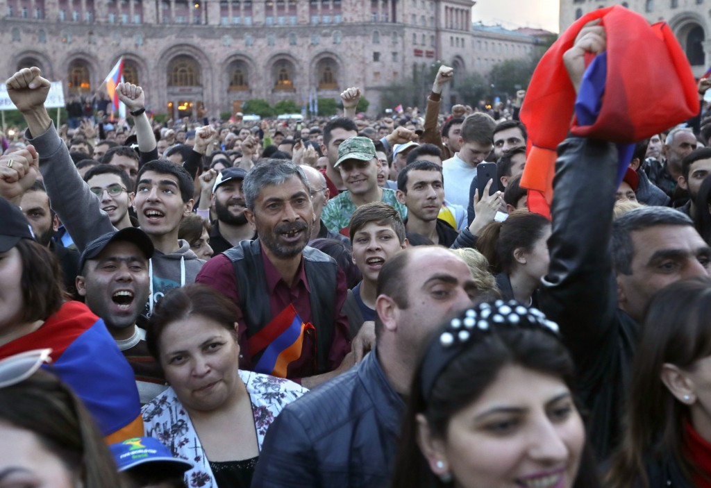 Protesters react while listening to their leader Nikol Pashinian during a rally in Yerevan, Armenia, Sunday, April 29, 2018. The leader of the wave of...
