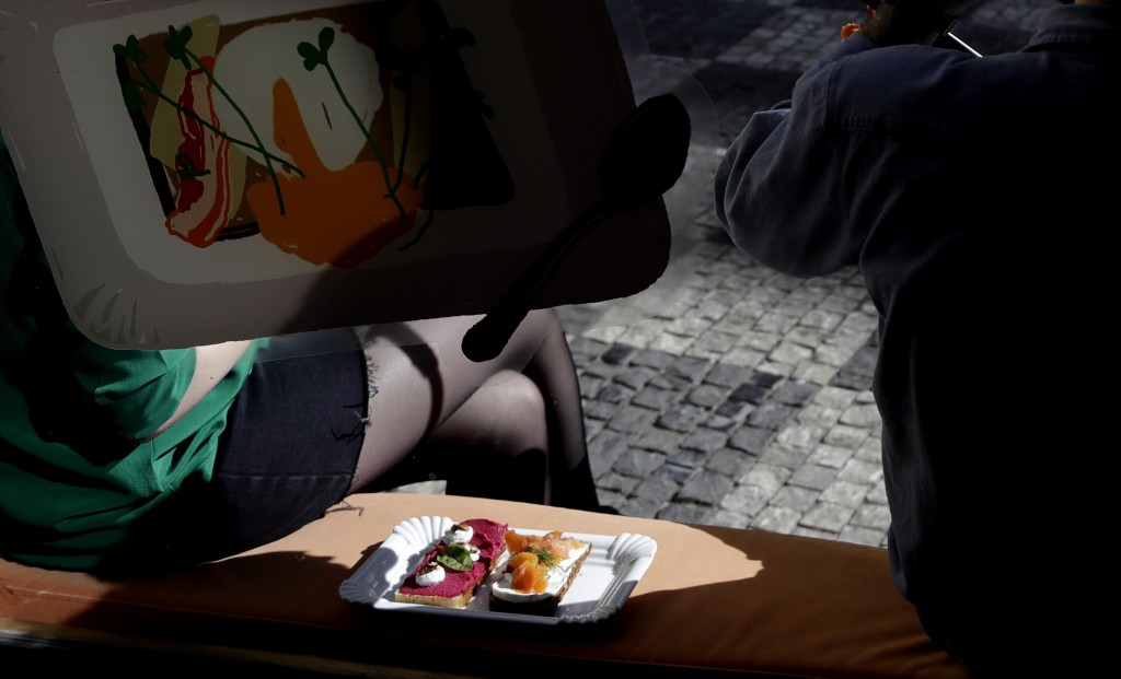 In this picture taken on Tuesday, April 10, 2018, a couple enjoys open-face sandwiches at bistro Sisters in Prague, Czech Republic. With an undying po...