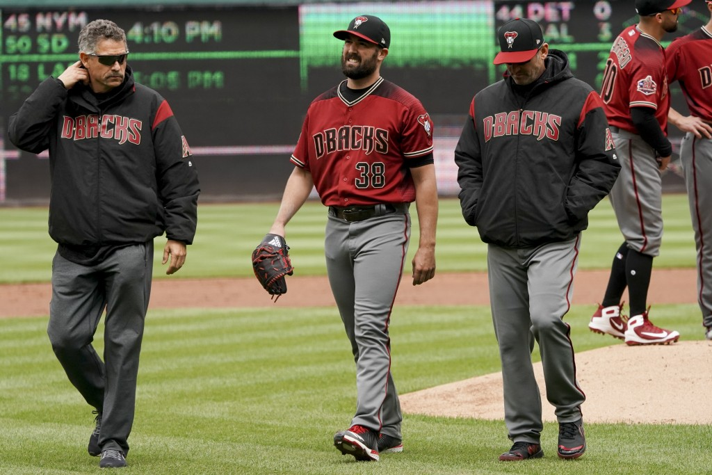 Arizona Diamondbacks starting pitcher Robbie Ray (38) leaves the game during the second inning of a baseball game against the Washington Nationals at ...