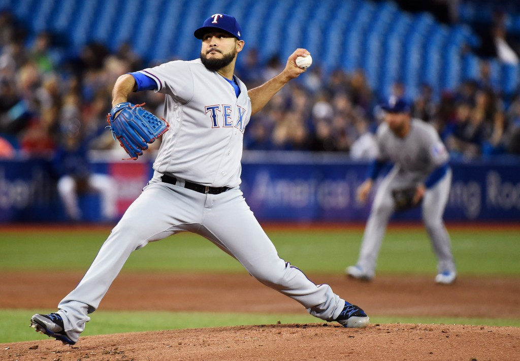Texas Rangers starting pitcher Martin Perez (33) works against the Toronto Blue Jays during first inning AL baseball action in Toronto on Sunday, Apri...