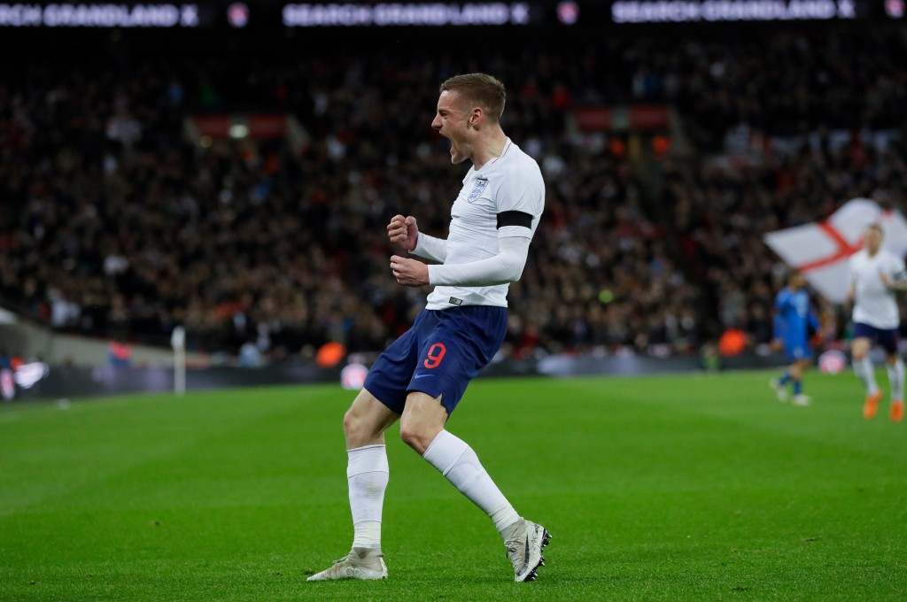FILE - In this Tuesday, March 27, 2018 file photo, England's Jamie Vardy celebrates after scoring his side's opening goal during the international fri...