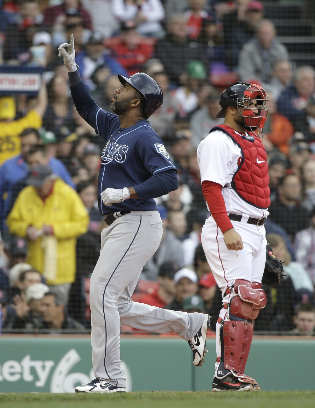 Tampa Bay Rays' Denard Span, left, celebrates as he scores on a two-run home run as Boston Red Sox's Sandy Leon, right, looks on in the third inning o...