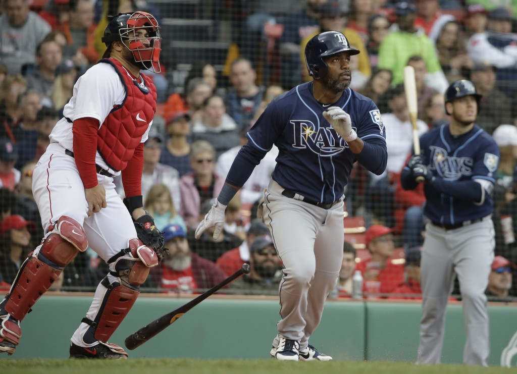 Tampa Bay Rays' Denard Span, center, watches the flight of his two-run home run off a pitch by Boston Red Sox's Rick Porcello as Red Sox's Sandy Leon,...