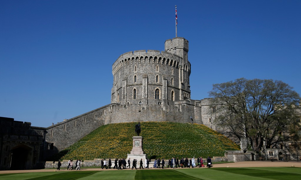FILE - In this April 20, 2018, file photo, leaders of Commonwealth countries arrive and walk past the round tower at Windsor Castle for the the second...