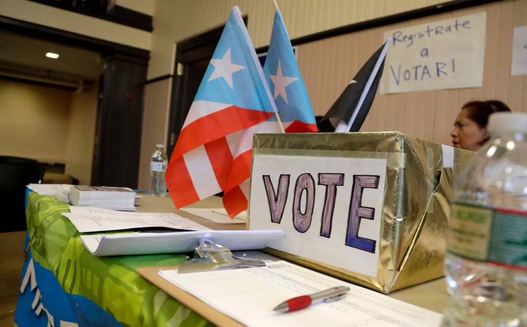 In this April 14, 2018 photo, a voter registration booth stands during an event to help Puerto Rico hurricane victims in Elizabeth, New Jersey. The in...