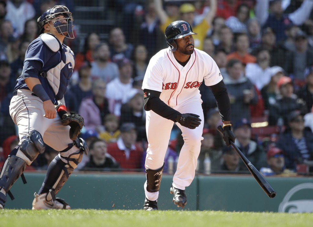 Boston Red Sox's Jackie Bradley Jr., right, watches the flight of his sacrifice fly as Tampa Bay Rays' Jesus Sucre, left, looks on in the sixth inning...