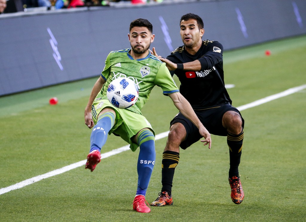 Seattle Sounders midfielder Alex Roldan (16) vies with Los Angeles FC defender Steven Beitashour (3) in the first half of an MLS soccer game at Banc o...