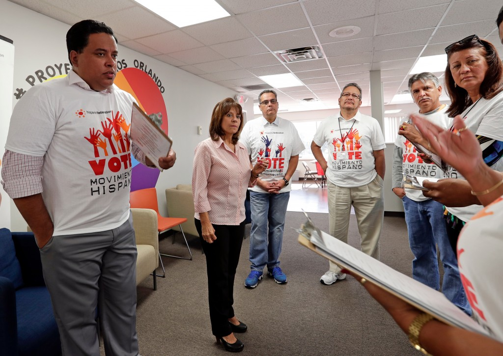 In this April 18, 2018 photo, Betsy Franceschini, second from left, senior state director of the Florida Southeast Hispanic Federation, briefs a group...
