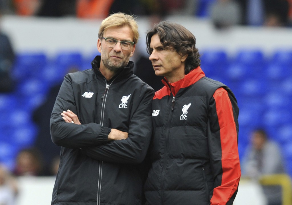 FILE - In this file photo dated Saturday, Oct. 17, 2015, Liverpool manager Juergen Klopp, left, talks with assistant manager Zeljko Buvac before their...