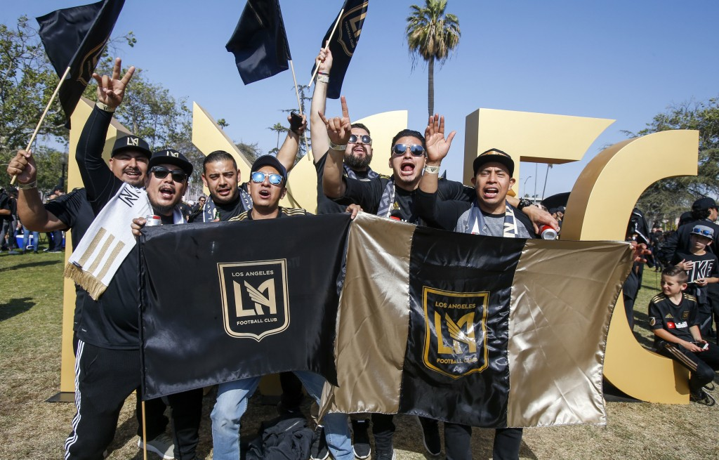 Fans pose outside the new Banc of California Stadium prior to an MLS soccer game between Los Angeles FC and the Seattle Sounders in Los Angeles, Sunda...