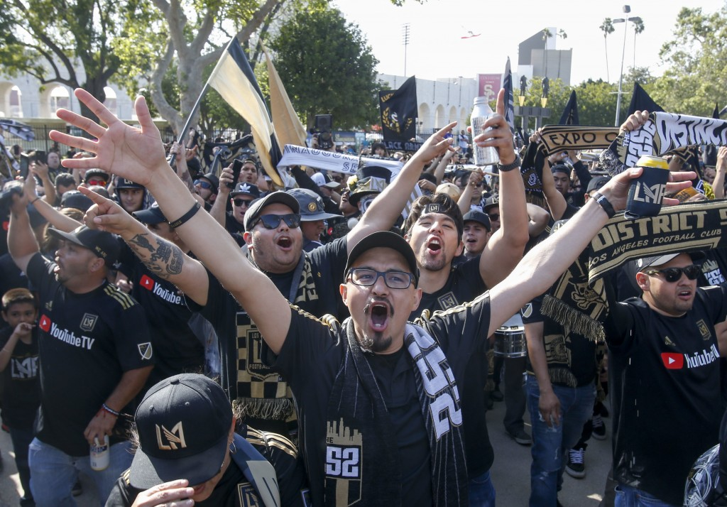 Fans of Los Angeles FC march outside the new Banc of California Stadium prior to an MLS soccer game against the Seattle Sounders in Los Angeles, Sunda...