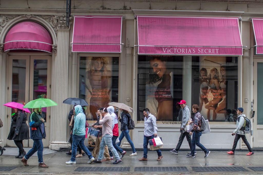 FILE- In this April 4, 2018, file photo, shoppers walk past the Victoria's Secret store on Broadway in the Soho neighborhood of New York. On Monday, A...