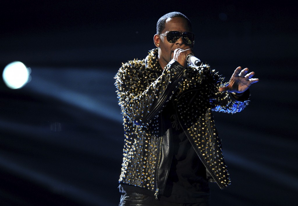 FILE - In this June 30, 2013, file photo, R. Kelly performs onstage at the BET Awards at the Nokia Theatre in Los Angeles. The Time's Up campaign is t...