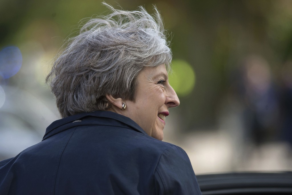 Britain's Prime Minister Theresa May leaves after visiting Brooklands Primary School in Sale, near Manchester, England, as part of the Conservative Pa...