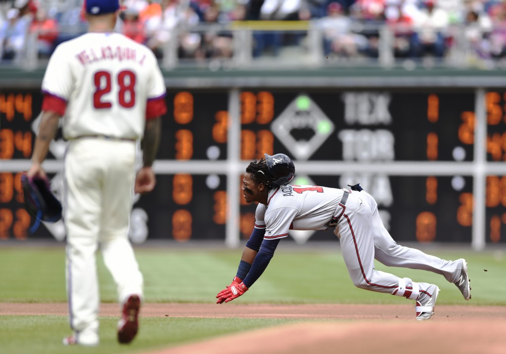 Atlanta Braves' Ronald Acuna Jr., right, dives into second base on a double to right field in the first first inning of a baseball game against the Ph...