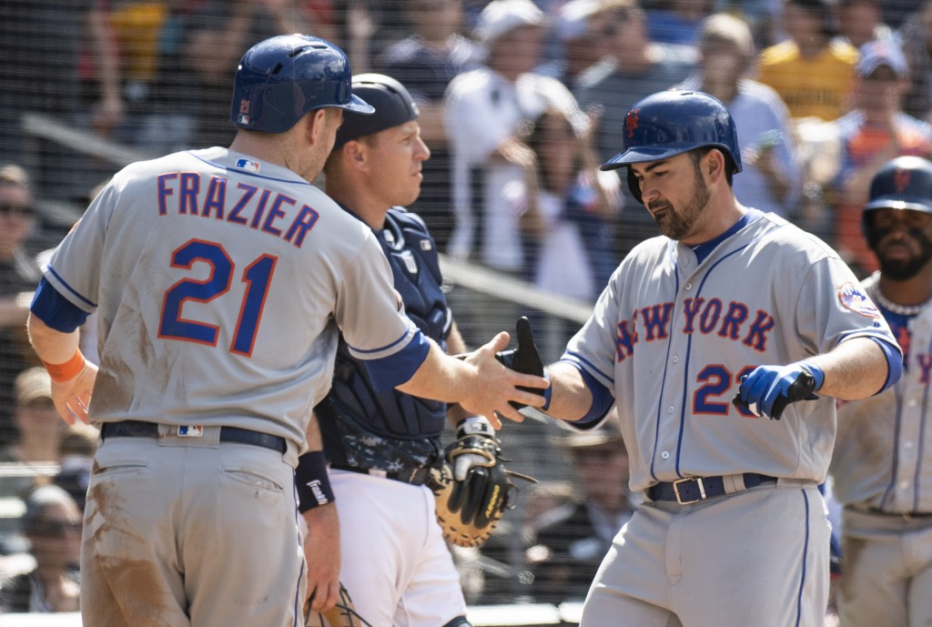 New York Mets' Adrian Gonzalez, right, celebrates his three-run homer with New York Mets' Todd Frazier, left, as San Diego Padres catcher A.J. Ellis l...