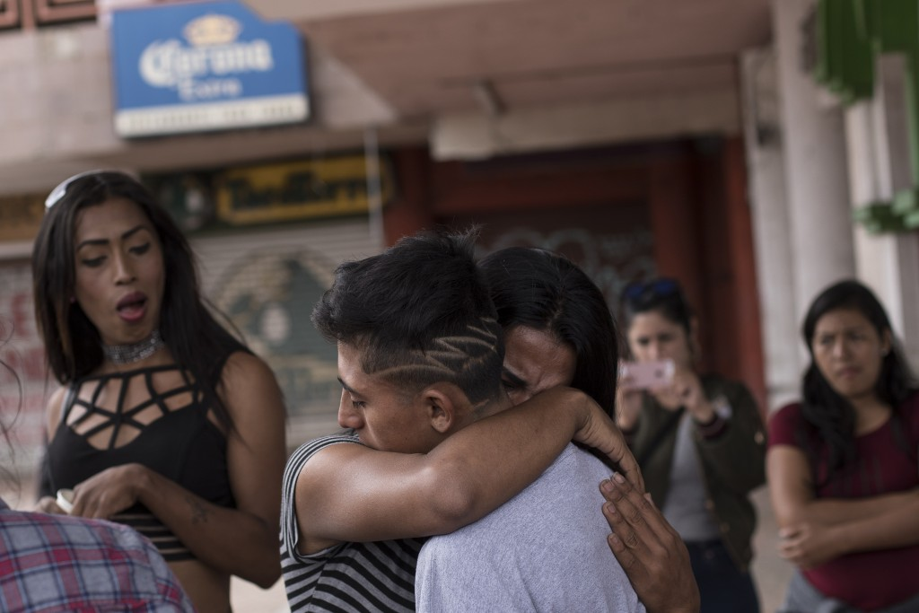 Central Americans who travel with a caravan of migrants embrace in Tijuana, Mexico, before crossing the border and request asylum in the United States...