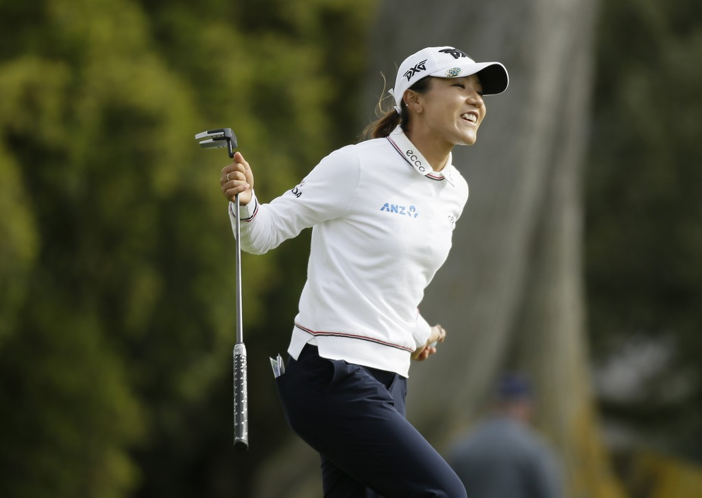 Lydia Ko, of New Zealand, reacts after making a birdie on the 15th green of the Lake Merced Golf Club during the final round of the LPGA Mediheal Cham...