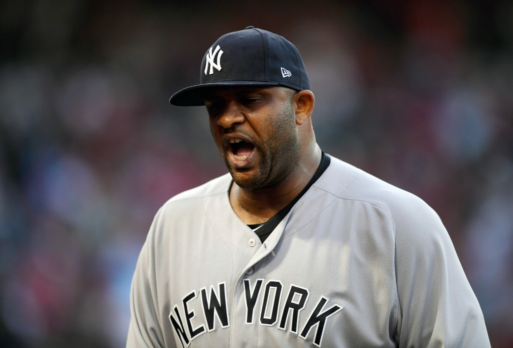 New York Yankees starting pitcher CC Sabathia yells as he gets out of the fourth inning after giving up one run in a baseball game against the Los Ang...