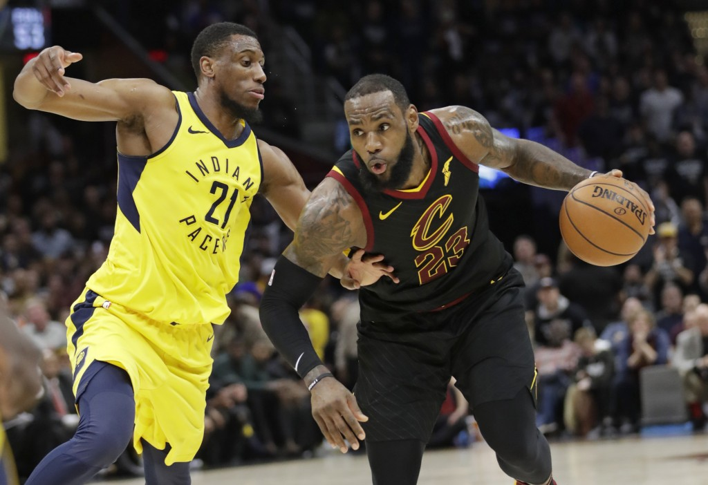 Cleveland Cavaliers' LeBron James (23) drives against Indiana Pacers' Thaddeus Young (21) in the first half of Game 7 of an NBA basketball first-round...