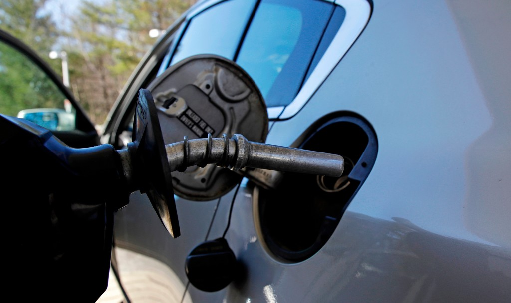 In this April 23, 2018, photo, a car is filled with gasoline at a station in Windham, N.H. Crude oil prices are at the highest level in more than thre...