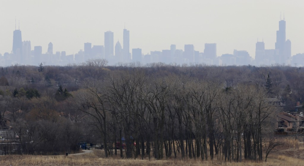 FILE - In this March 19, 2015, file photo, a thick haze of smog looms over the skyline of Chicago. A new study in the Proceedings of the National Acad...