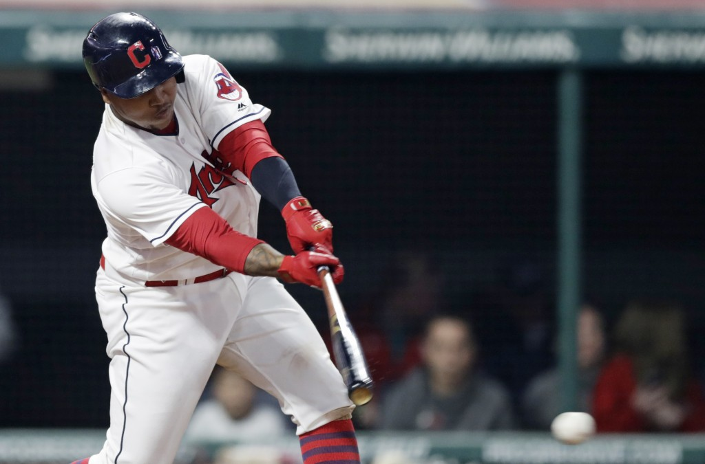 Cleveland Indians' Jose Ramirez hits an RBI-single off Texas Rangers relief pitcher Alex Claudio in the seventh inning of a baseball game, Monday, Apr...
