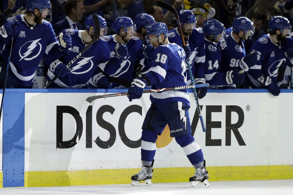 Tampa Bay Lightning left wing Ondrej Palat (18) celebrates with the bench after his goal against the Boston Bruins during the third period of Game 2 o...