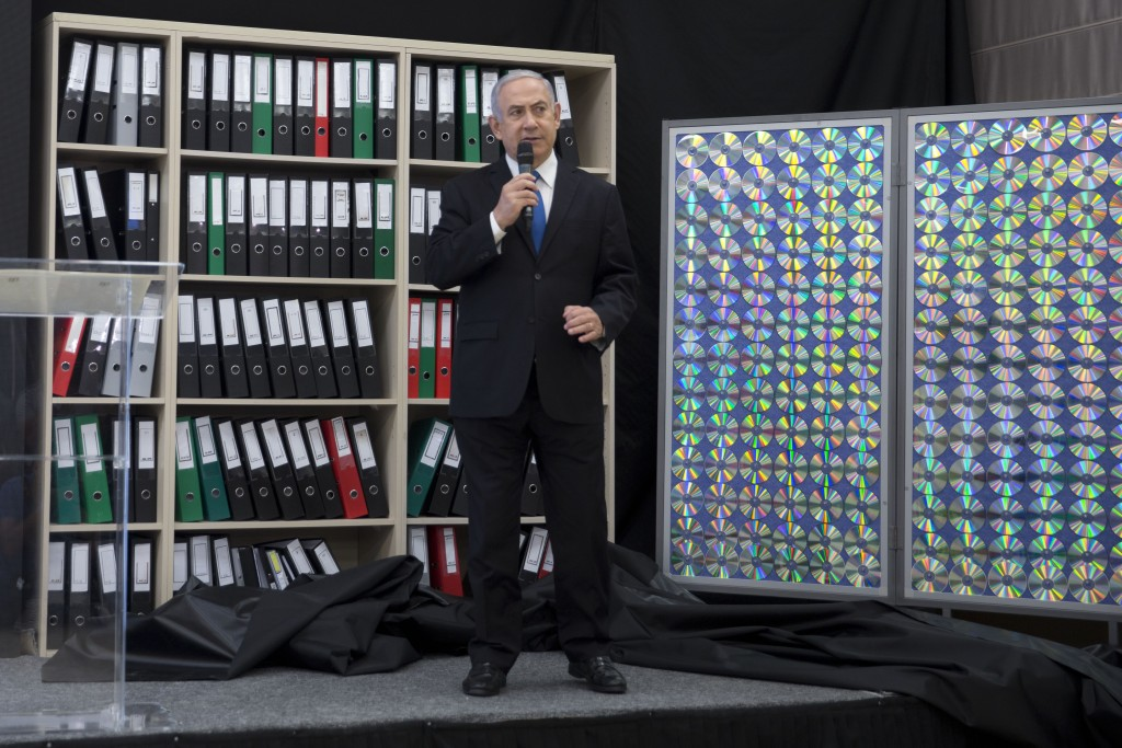 Israeli Prime Minister Benjamin Netanyahu presents material on Iranian nuclear weapons development during a press conference in in Tel Aviv, Israel, M...