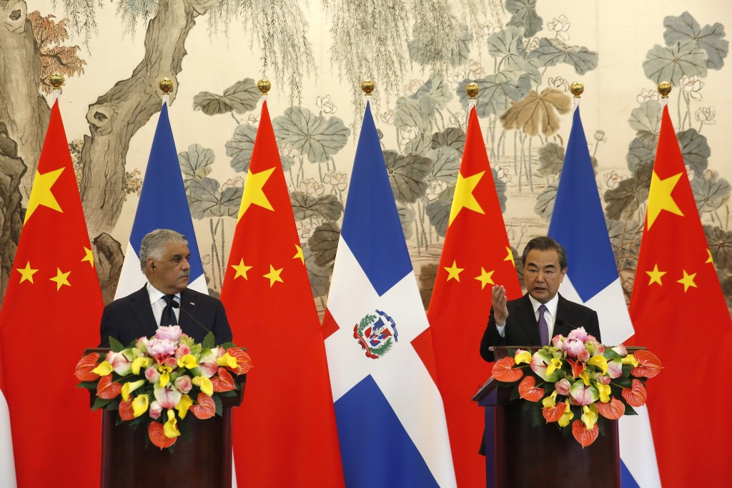 Chinese Foreign Minister Wang Yi, right, speaks during a press briefing with Dominican Foreign Minister Miguel Vargas after they signed the joint comm...
