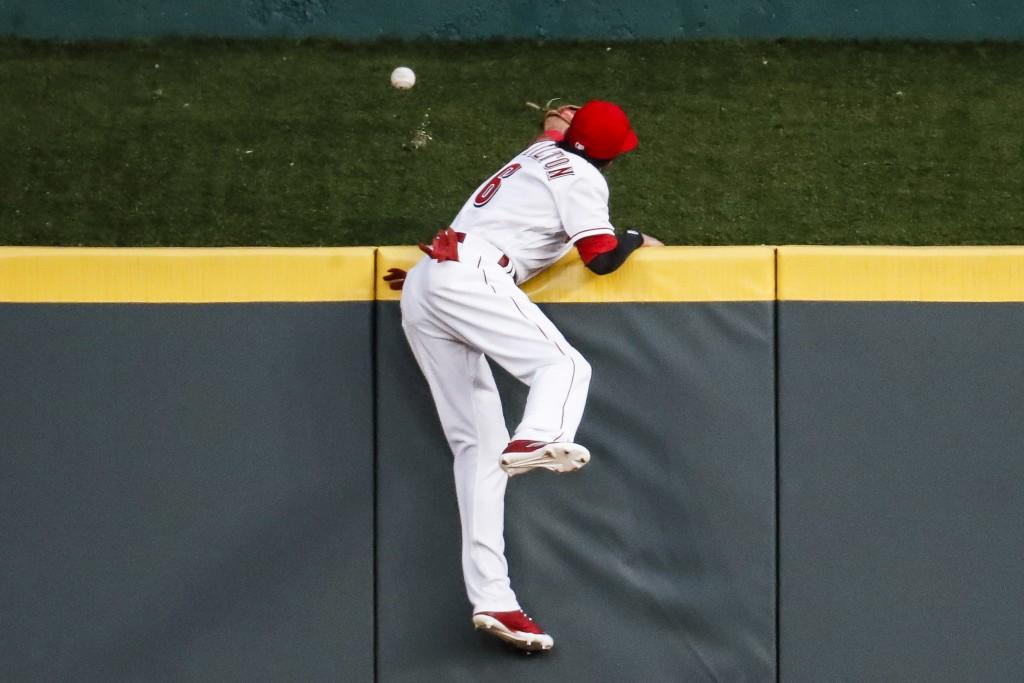 Cincinnati Reds center fielder Billy Hamilton (6) cannot reach a solo home run hit by Milwaukee Brewers' Manny Pina off starting pitcher Brandon Finne...