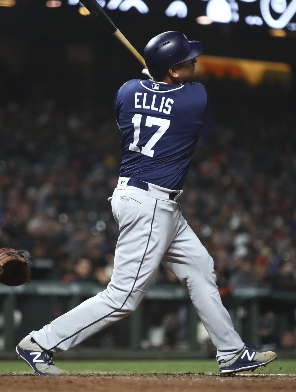 San Diego Padres' A.J. Ellis swings for an RBI-sacrifice fly against the San Francisco Giants during the sixth inning of a baseball game, Monday, Apri...