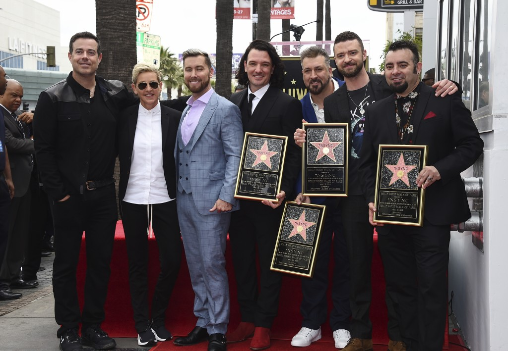 Carson Daly, from left, Ellen DeGeneres, Lance Bass, JC Chasez, Joey Fatone, Justin Timberlake and Chris Kirkpatrick attend a ceremony honoring NSYNC ...