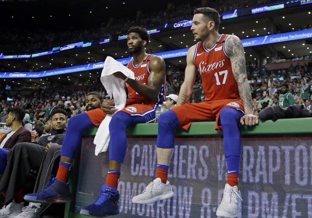 Philadelphia 76ers center Joel Embiid, left, and guard JJ Redick (17) react at the bench near the end of Game 1 of an NBA basketball second-round play...