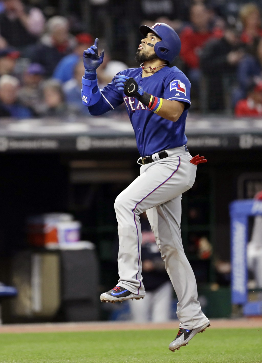 Texas Rangers' Robinson Chirinos celebrates as he runs the bases after hitting a solo home run off Cleveland Indians starting pitcher Trevor Bauer in ...
