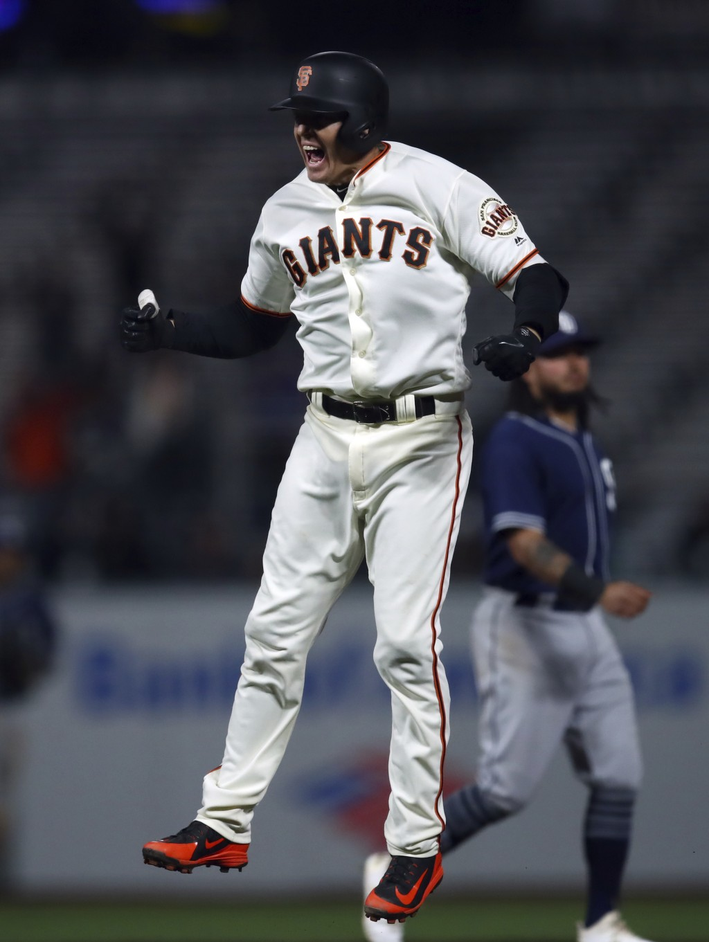 San Francisco Giants' Nick Hundley celebrates after making the game-winning hit against the San Diego Padres in the ninth inning of a baseball game, M...