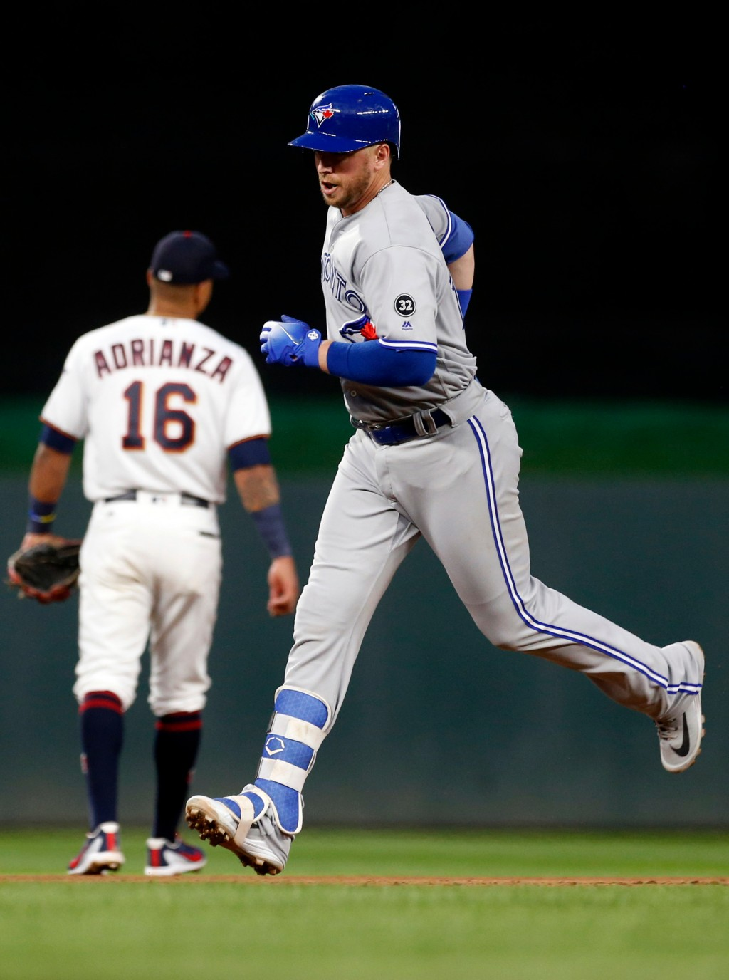 Toronto Blue Jays' Justin Smoak rounds the base path on a two-run home run off Minnesota Twins pitcher Lance Lynn in the fourth inning of a baseball g...