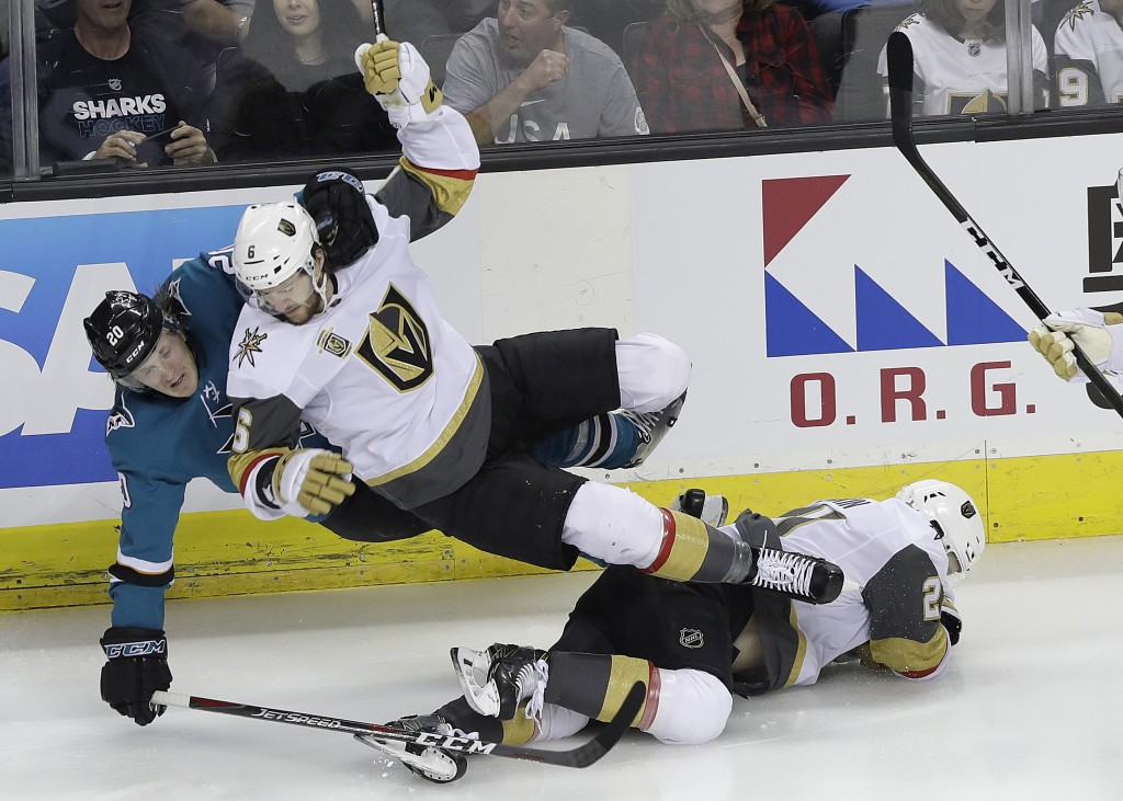 San Jose Sharks left wing Marcus Sorensen, from Sweden, left, and Vegas Golden Knights defenseman Colin Miller fall over Cody Eakin during the first p...