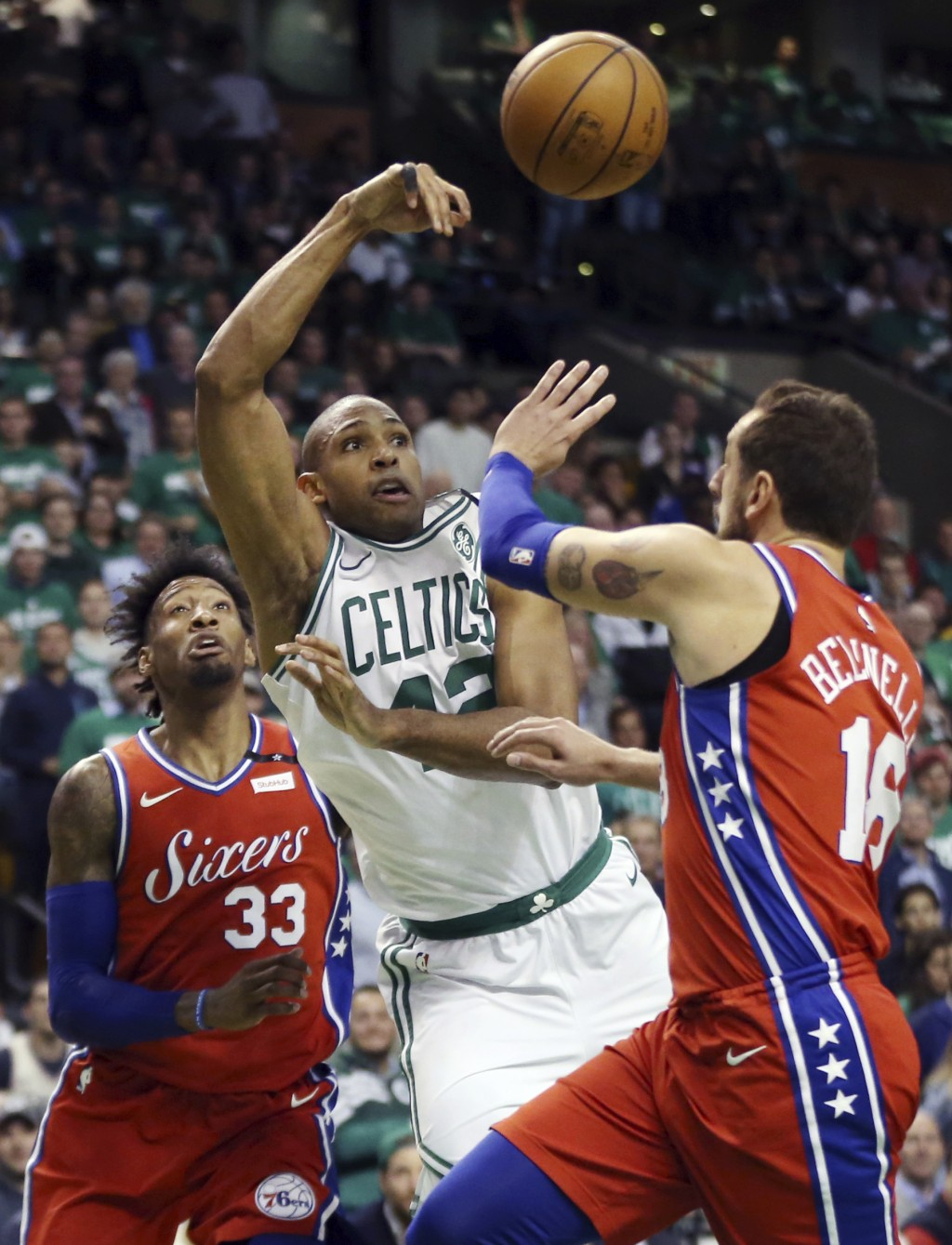 Boston Celtics forward Al Horford (42) passes the ball against the defense of Philadelphia 76ers forward Robert Covington (33) and guard Marco Belinel...