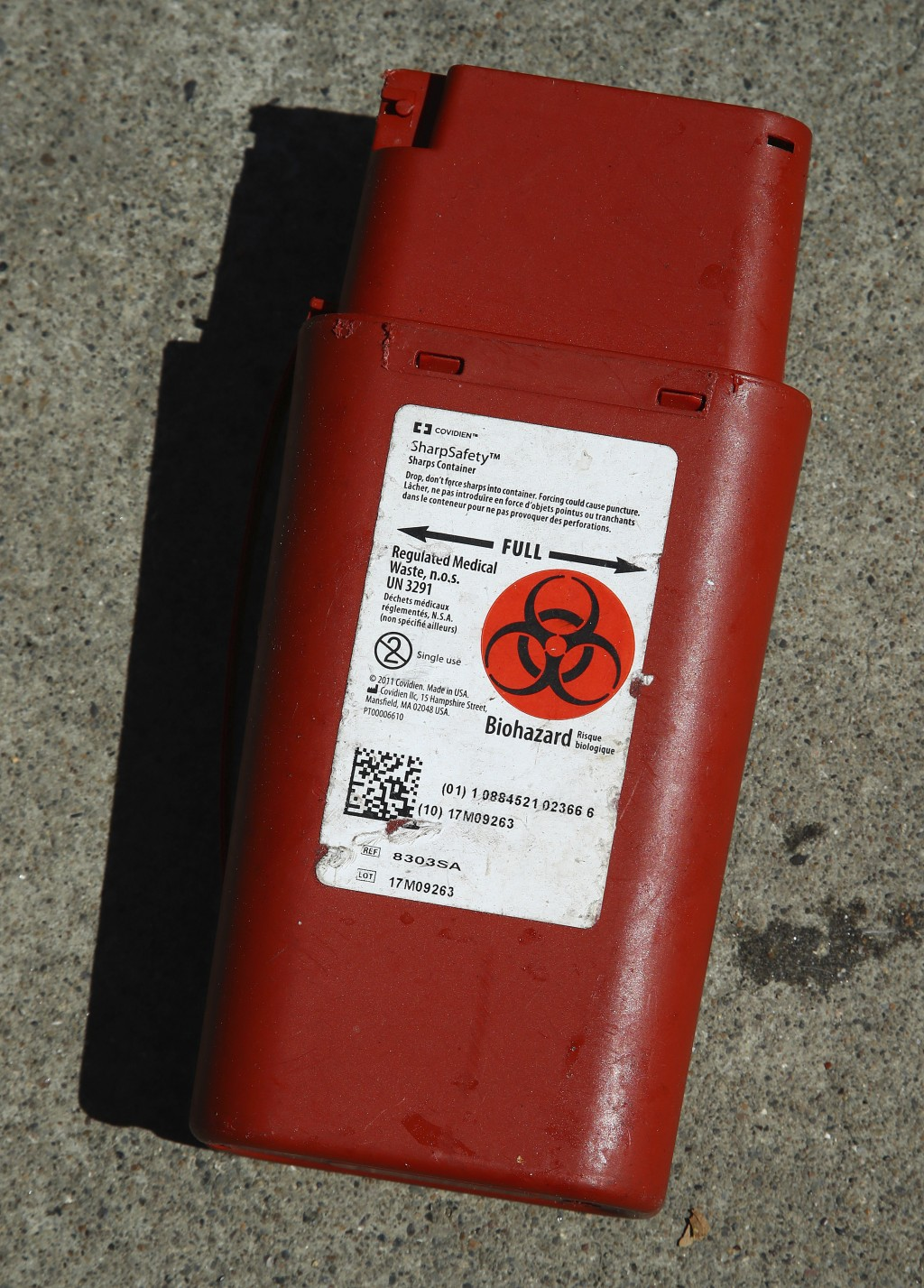 In this photo taken on Thursday, April 26, 2018, a biohazard container used for the storage of used needles sits on a sidewalk in San Francisco. San F...