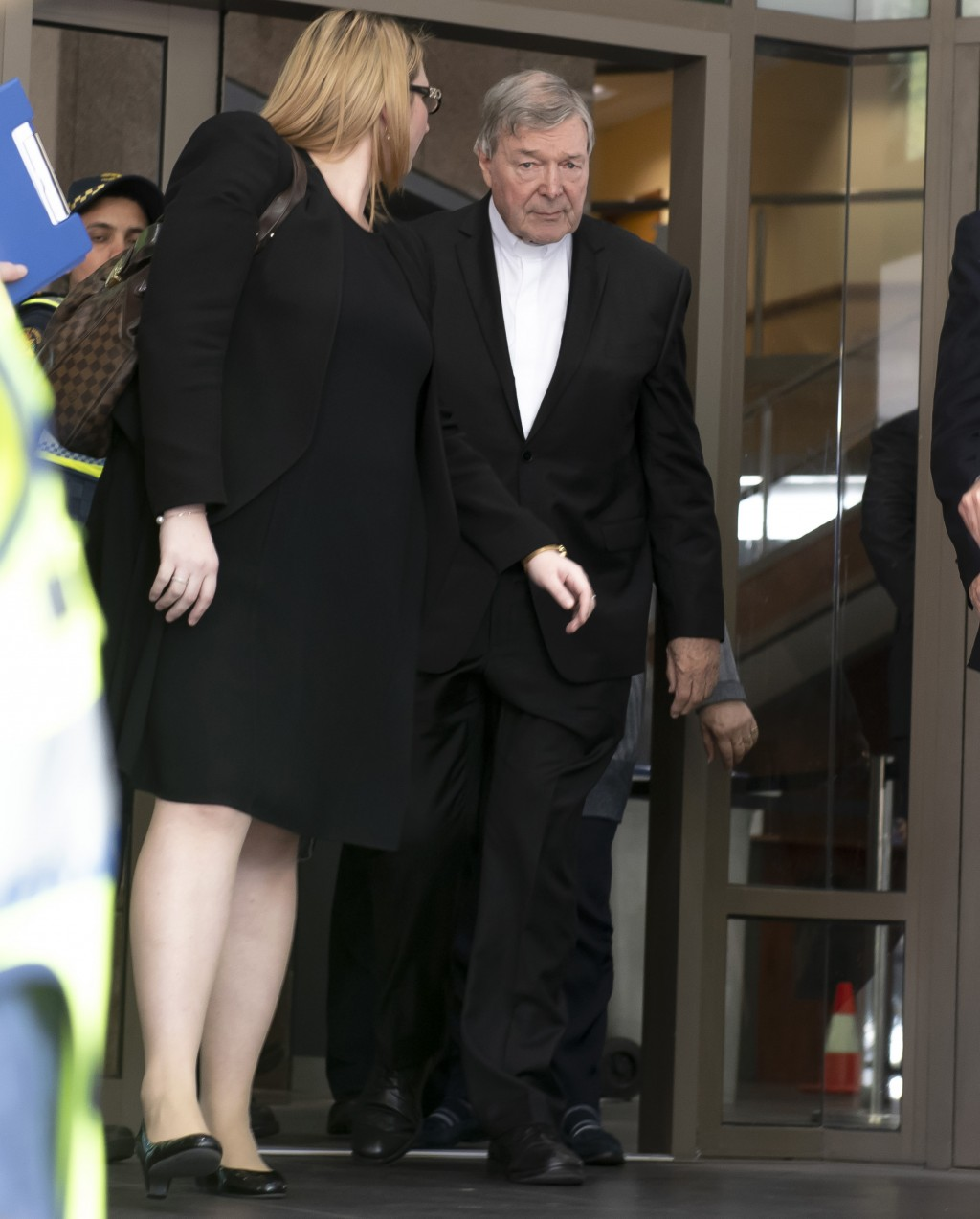 Australian Cardinal George Pell, right leaves the Melbourne Magistrate Court in Melbourne Tuesday, May 1, 2018.  Australian Cardinal Pell, the most se...