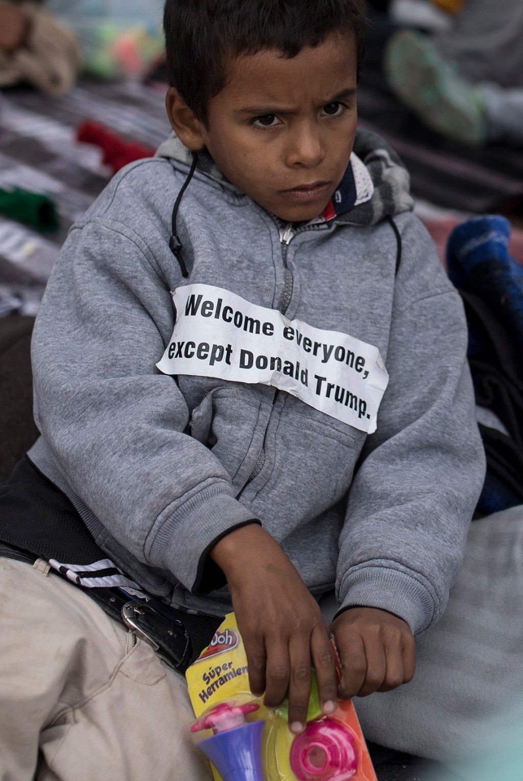 A youth who traveled with the annual caravan of Central American migrants rests where the group set up camp to wait for access to request asylum in th...