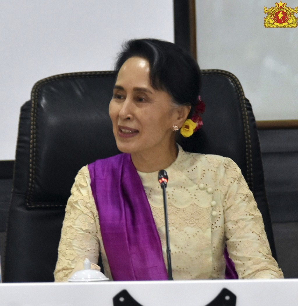 In this April 30, 2018, image provided by Myanmar's State Counsellor Office Facebook page, Myanmar's leader Aung San Suu Kyi, smiles during their meet...