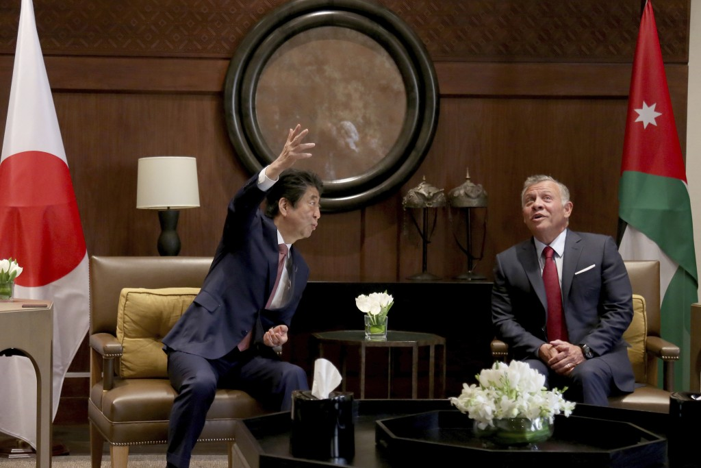 Japanese Prime Minister Shinzo Abe, left, meets with King Abdullah II at the Husseiniya Palace in Amman, Jordan, Tuesday, May 1, 2018. (AP Photo/Raad ...