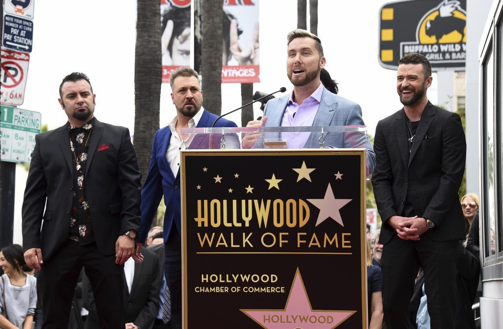 Lance Bass speaks at a ceremony honoring NSYNC with a star on the Hollywood Walk of Fame on Monday, April 30, 2018, in Los Angeles. Joining Bass are f...