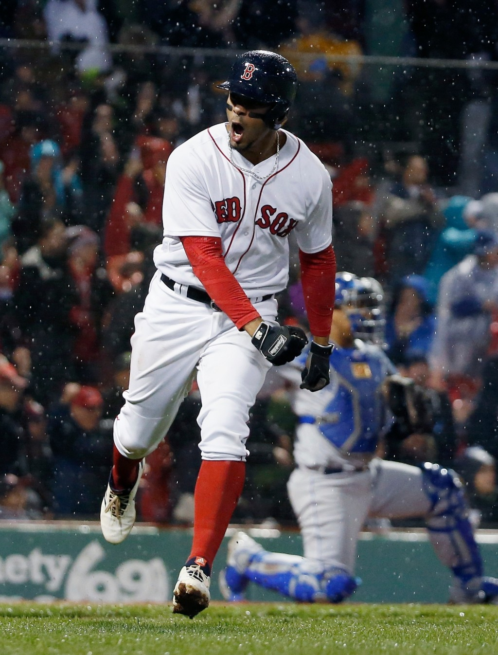 Boston Red Sox's Xander Bogaerts reacts after hitting a grand slam during the third inning of a baseball game against the Kansas City Royals in Boston...